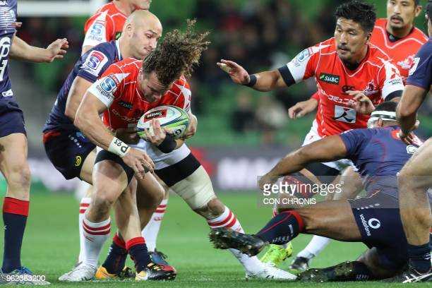 Sunwolves' Michael Little is tackled by Rebels' Billy Meakes during the Super Rugby match between Australia's Rebels and Japan's Sunwolves in...