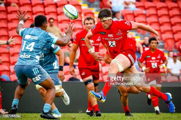Sunwolves' Michael Stolberg kicks over the head of Crusaders' Sevu Reec during the Super Rugby match between Japan's Sunwolves and New Zealand's...