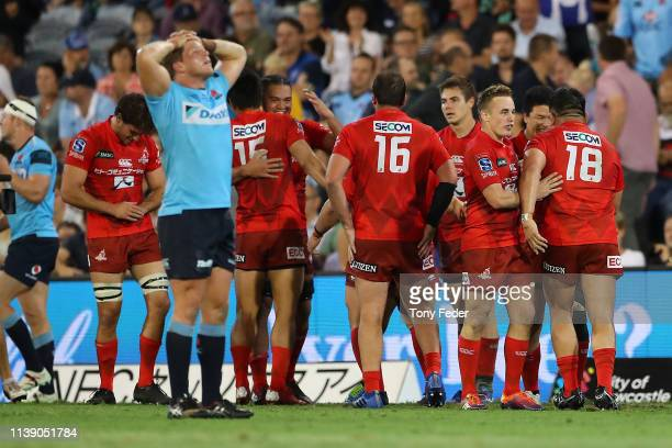 Sunwolves players celebrate the win over the Waratahs during the round seven Super Rugby match between the Waratahs and the Sunwolves at McDonald...