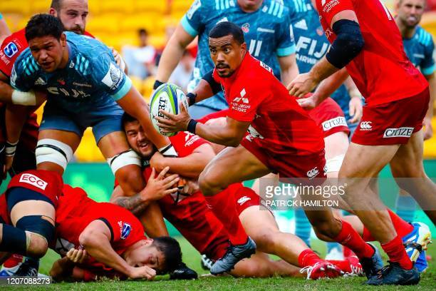 Sunwolves' Rudy Paige is tackled during the Super Rugby match between Japan's Sunwolves and New Zealand's Crusaders in Suncorp Stadium in Brisbane on...