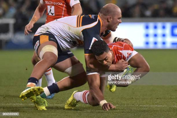 TOPSHOT Sunwolves' Sione Teaupa is tackled by Brumbies' Lach McCaffrey during the Super Rugby match between the ACT Brumbies and Japan's Sunwolves in...