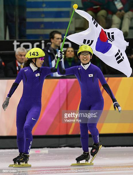 SunYu Jin and ChunSa Byun of Korea celebrate after winning the gold medal in the women's 3000m final speed skating during Day 12 of the Turin 2006...