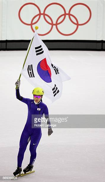 SunYu Jin of Korea celebrates winning the gold medal with a time of 132859 in the women's 1000 meter final in Short Track Speed Skating on Day 15 of...