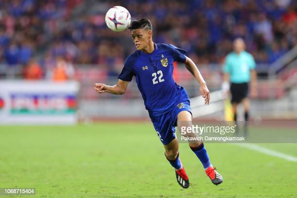 Supachai Chaided of Thailand heads the ball during the AFF Suzuki Cup semi final second leg match between Thailand and Malaysia at Rajamangala...