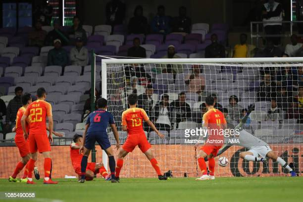 Supachai Chaided of Thailand scores the first goal to make it 1-0 during the AFC Asian Cup round of 16 match between Thailand and China at Hazza Bin...