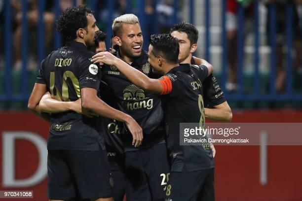Supachok Sarachart of Buriram United FC celebrates scoring his side's goal with his team mates during the Thai League 1 match between Bangkok Glass...