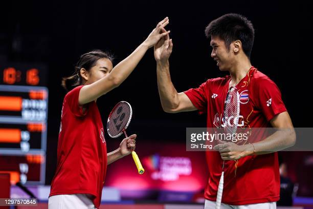 Supak Jomkoh and Supissara Paewsampran of Thailand celebrate the victory in the Mixed Doubles second round match against Marcus Ellis and Lauren...