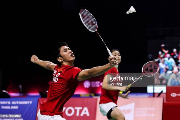 Supak Jomkoh and Supissara Paewsampran of Thailand compete in the Mixed Doubles second round match against Marcus Ellis and Lauren Smith of England...