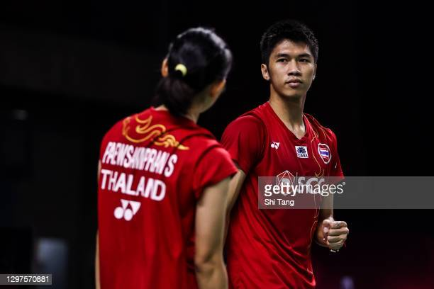 Supak Jomkoh and Supissara Paewsampran of Thailand react in the Mixed Doubles second round match against Marcus Ellis and Lauren Smith of England on...