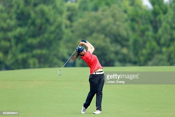 Supamas Sangchan of Thailand plays a shot during the Women's Individual Stroke Play on day five of the Nanjing 2014 Summer Youth Olympic Games at...