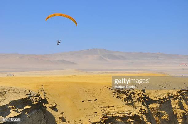 "supay beach paraglider in paracas desert, peru - ""markus daniel"" stock pictures, royalty-free photos & images"