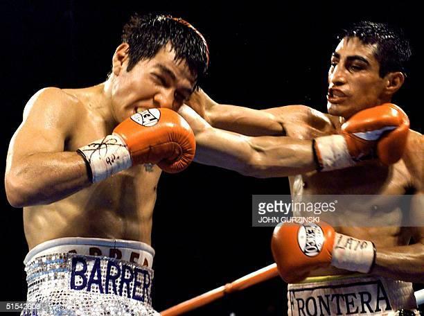 Super Bantamweight Champion Erik Morales of Tijuana Mexico lands a right to the head of WBO Super Welterweight Champion Marco Antonio Barrera of...