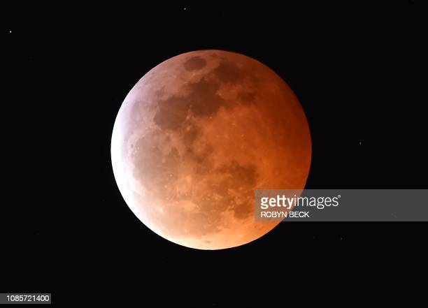 A Super Blood Moon is seen during a total lunar eclipse in Los Angeles California on January 20 2019