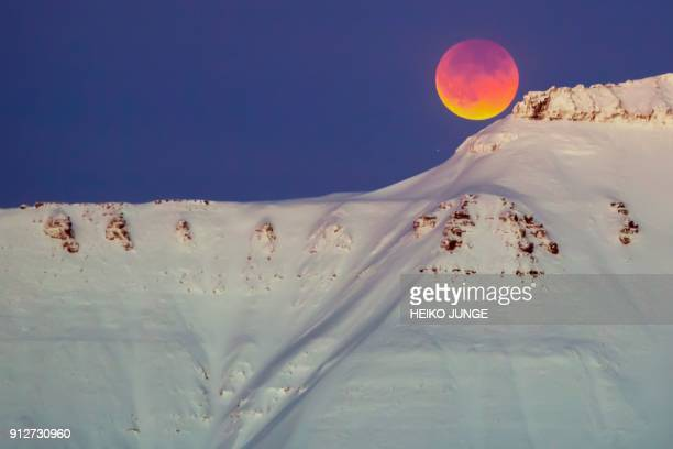 A super blue blood moon behind a mountain is seen from Longyearbyen Svalbard Norway on January 31 2018 PHOTO / NTB scanpix AND NTB Scanpix / Heiko...