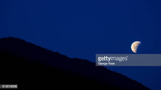 A 'super blue blood moon' lunar eclipse is viewed in the early morning hours of January 31 in Buellton California Because of its close proximity to...