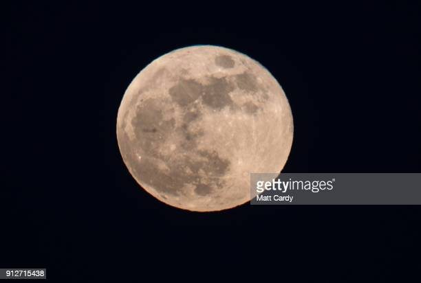 Super Blue Blood Moon rises above Portsmouth on January 31 2018 in Portsmouth United Kingdom A Super Blue Blood Moon is the result of three lunar...