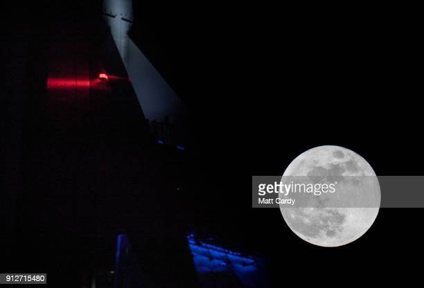 Super Blue Blood Moon rises above the Spinnaker Tower in Portsmouth on January 31 2018 in Portsmouth United Kingdom A Super Blue Blood Moon is the...