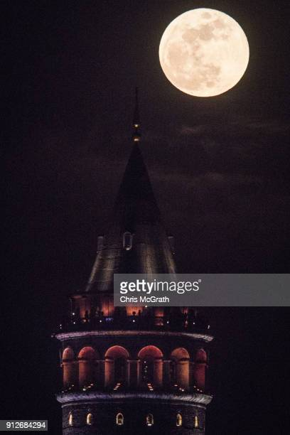 Super Blue Blood Moon rises behind Istanbul's famous Galata tower on January 31 2018 in Istanbul Turkey A Super Blue Blood Moon is the result of...