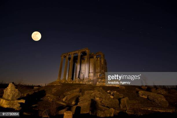'Super blue blood moon' rises over Aizanoi Ancient city in Cavdarhisar district of Kutahya on January 31 2018 The full moon on January 31st combines...