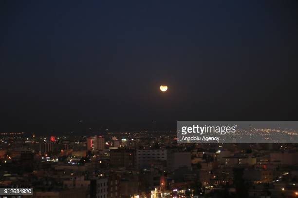 'Super blue blood moon' rises over Erbil city of Iraq on January 31 2018 The 'Super Blue Blood Moon' is a rare 'lunar trifecta' event in which the...