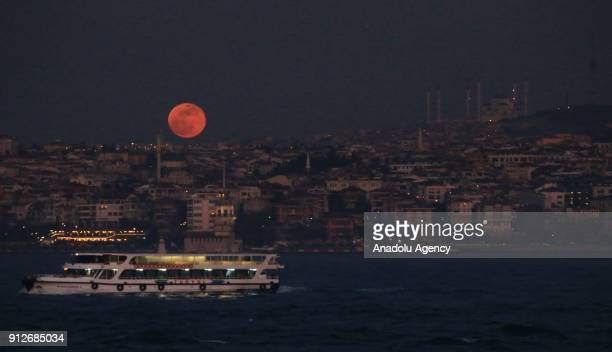 'Super blue blood moon' rises over Istanbul province of Turkey on January 31 2018 The full moon on January 31st combines three rare lunar events for...