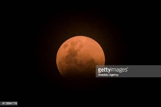 'Super blue blood moon' rises over Jakarta Indonesia on January 31 2018 The full moon on January 31st combines three rare lunar events for the first...