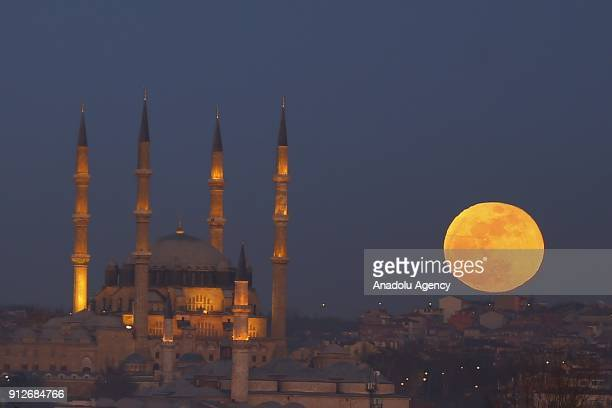 'Super blue blood moon' rises over Selimiye Mosque in Edirne District of Turkey on January 31 2018 The 'Super Blue Blood Moon' is a rare 'lunar...