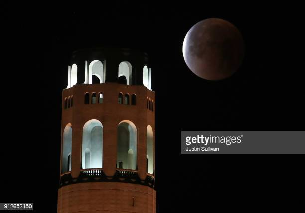 A super blue blood moon sets behind Coit Tower on January 31 2018 in San Francisco California The 'super blue blood moon' is a rare 'lunar trifecta'...