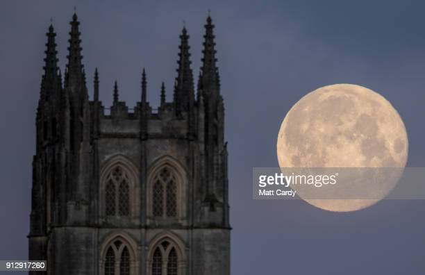 Super Blue Blood Moon sets behind Downside Abbey a Benedictine monastery in StrattonontheFosse on February 1 2018 in Somerset England Last night's...