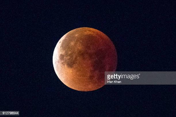 Super Blue Blood Moon sets over downtown Los Angeles skyline Wednesday morning January 31 2018 views from Cape Tenet Drive Whittier The Blue Moon a...