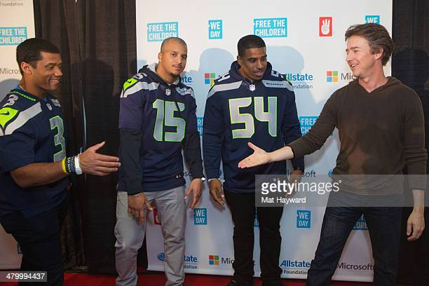 2014 Super Bowl Champions Seattle Seahawks players Russell Wilson Jermaine Kearse Bobby Wagner and actor Edward Norton pose for a photo on the red...