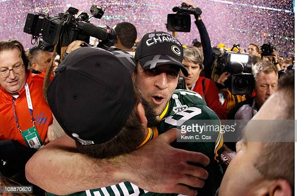 Super Bowl MVP Aaron Rodgers of the Green Bay Packers hugs teammate Brett Goode after winning Super Bowl XLV 31-25 against the Pittsburgh Steelers at...