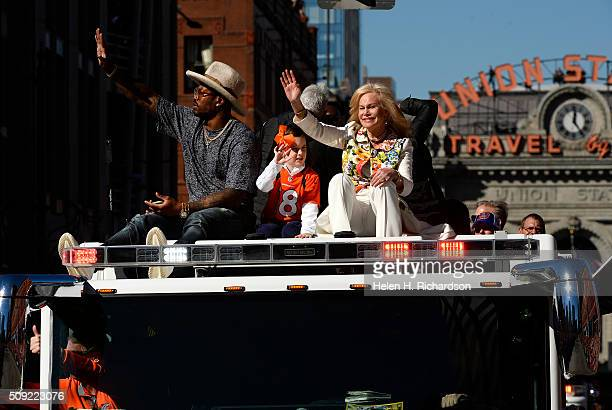 Super Bowl MVP and Broncos Linebacker Von Miller left sits atop a Denver Fire engine with Broncos owner Pat Bowlen's wife Annabel Bowlen right and...