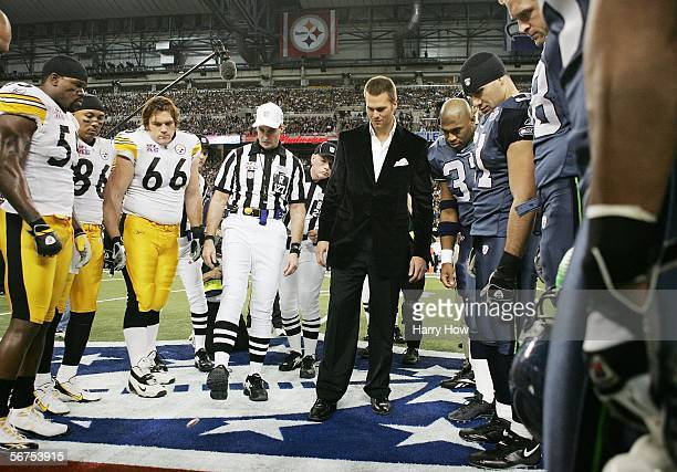 Super Bowl MVP and New England Patriots quarterback Tom Brady performs the coin toss before the start of Super Bowl XL between the Pittsburgh...