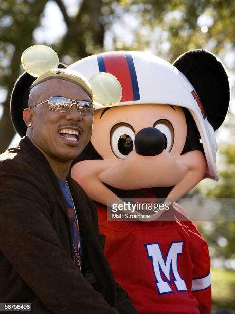 Super Bowl MVP Hines Ward of the Pittsburgh Steelers and Mickey Mouse wave at fans during a parade at Walt Disney World's Magic Kingdom February 6,...