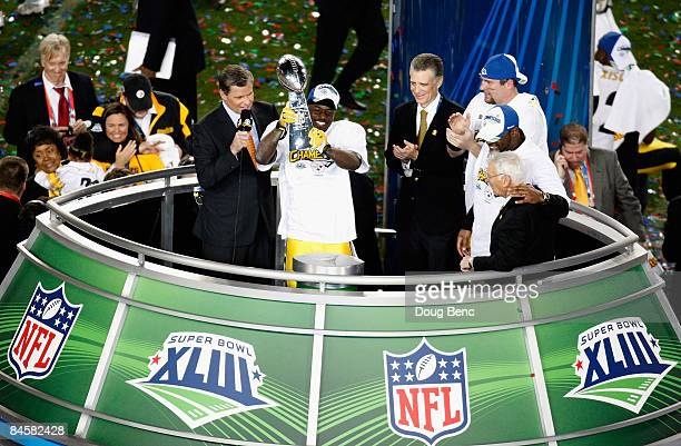 Super Bowl MVP Santonio Holmes of the Pittsburgh Steelers celebrates with the Vince Lombardi trophy after the Steelers won 27-23 against the Arizona...