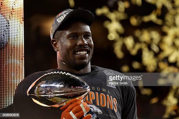 Super Bowl MVP Von Miller of the Denver Broncos celebrates with the Vince Lombardi Trophy after winning Super Bowl 50 at Levi's Stadium on February 7...