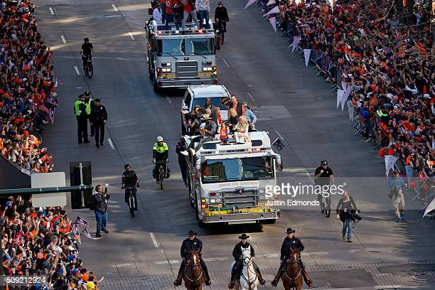 Super Bowl MVP Von Miller of the Denver Broncos holds the Lombardi Trophy while riding a fire truck with Demarcus Ware #18 Peyton Manning and Annabel...