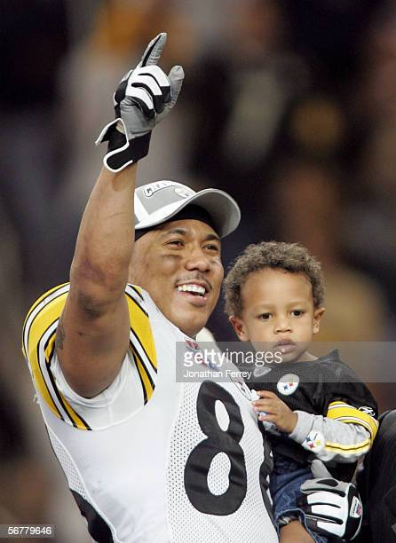 Super Bowl XL MVP Hines Ward of the Pittsburgh Steelers holds his son Jaden as he celebrates after defeating the Seattle Seahawks in Super Bowl XL at...