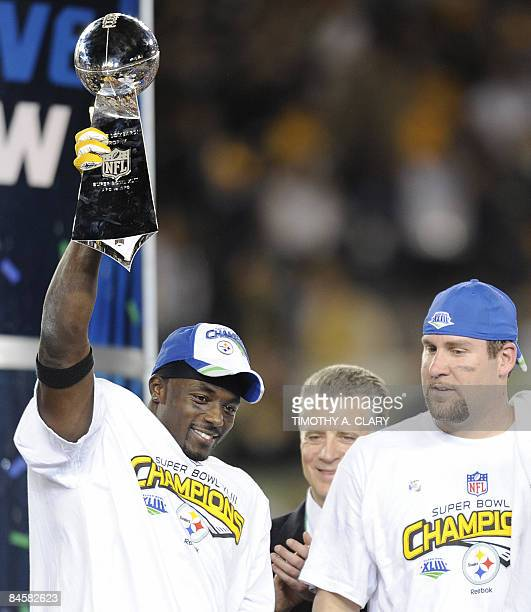 Super Bowl XLIII MVP Santonio Holmes of the Pittsburgh Steelers holds the trophy as quarterback Ben Roethlisberger looks on after defeating the...
