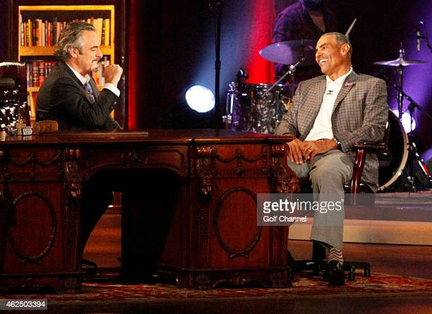 Host David Feherty and former football coach Herm Edwards speak onstage during 'Feherty Live' at the Orpheum Theatre Phoenix Arizona