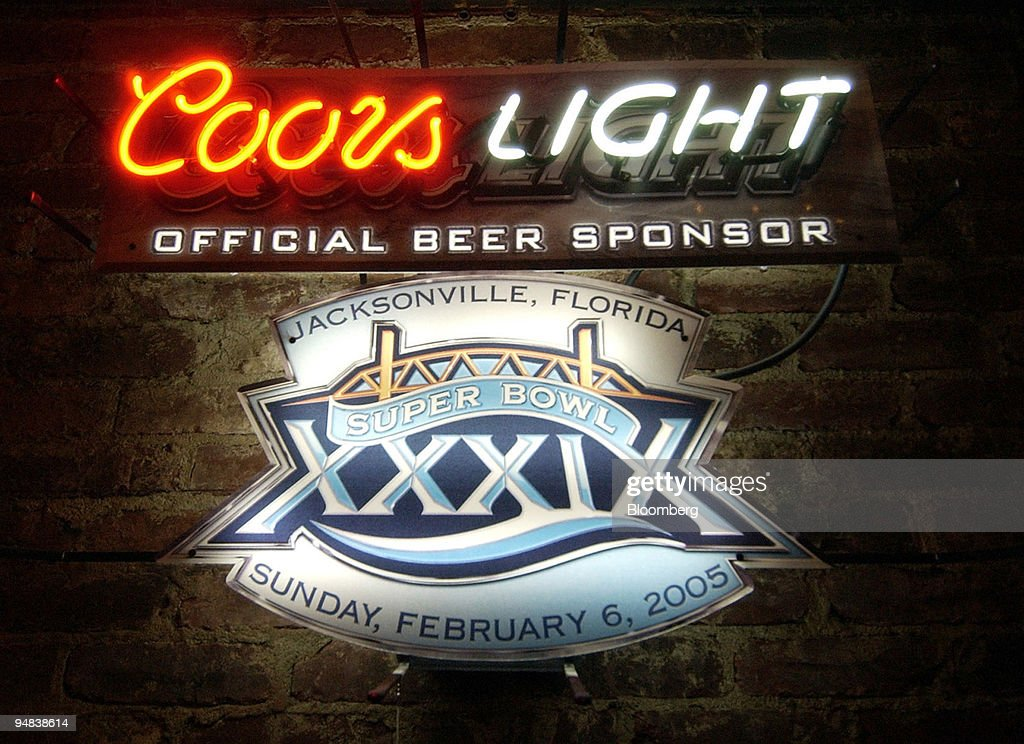 A super bowl xxxix and coors light neon light sign hangs in pictures a super bowl xxxix and coors light neon light sign hangs in mozeypictures Choice Image