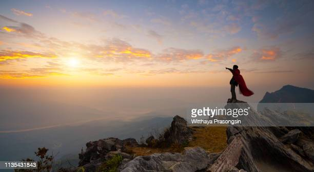 super business man look somewhere on the mountain - superhero stock pictures, royalty-free photos & images