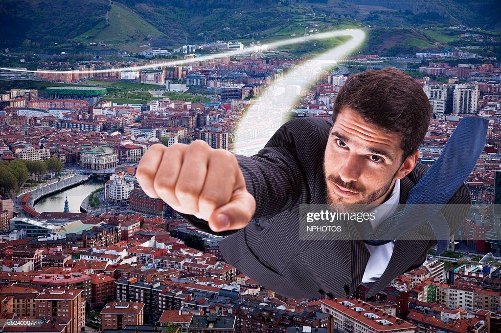 Super businessman flying : Stock Photo
