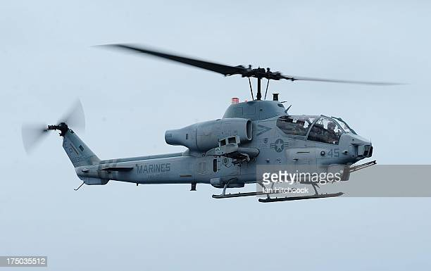 Super Cobra helicopter comes in to land on the deck of the USS Bonhomme Richard on July 30 2013 near Rockhampton Australia Over 30000 US and...