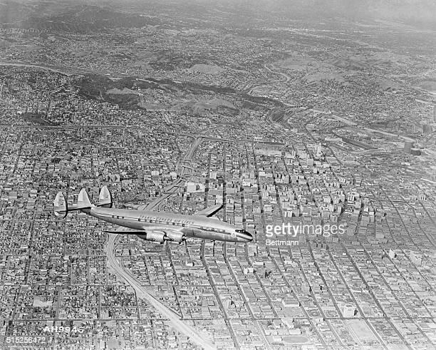 A Super Constellation flying over downtown Los Angeles The ribbon like roadway directly beneath the plane is the city's newest section of...