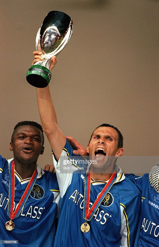 UEFA Super Cup Final, 1998, 28th AUGUST 1998. Monaco. Chelsea 1 v Real Madrid 0. Chelsea's goalscorer Gustavo Poyet lifts the trophy alongside Marcel Desailly after Chelsea won the European Super Cup. : News Photo