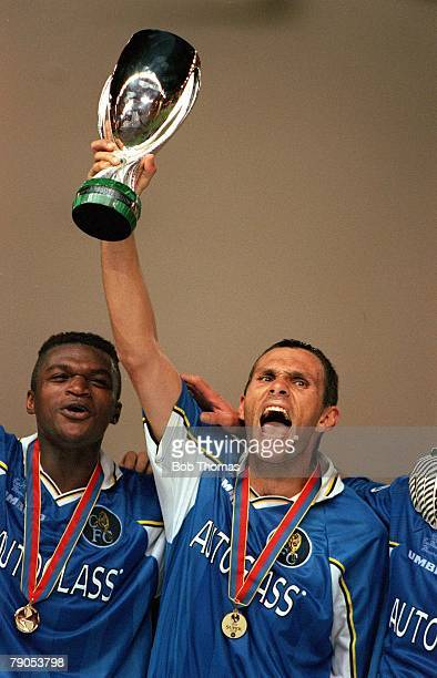Super Cup Final 28th AUGUST 1998, Monaco, Chelsea 1 v Real Madrid 0, Chelsea's goalscorer Gustavo Poyet lifts the trophy alongside Marcel Desailly...