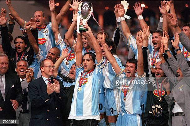 Super Cup Final Monaco 27th August Lazio 1 v Manchester United 0 Lazio captain Alessandro Nesta holds aloft the Super Cup trophy as the rest of the...