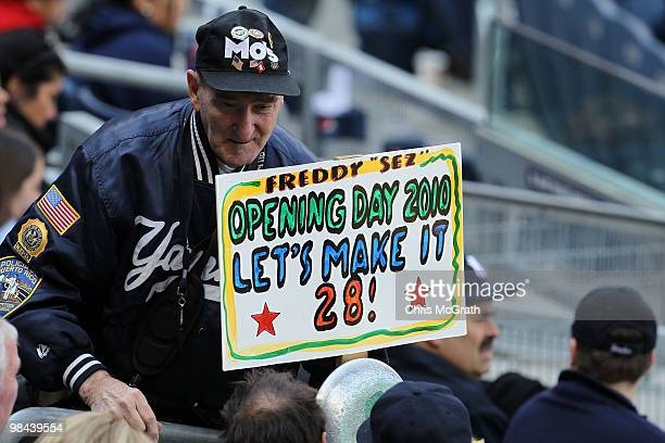 Super fan Freddy Sez holds up a sign reading Opening Day 2010 Let's Makes It 28 as the New York Yankees play against the Los Angeles Angels of...